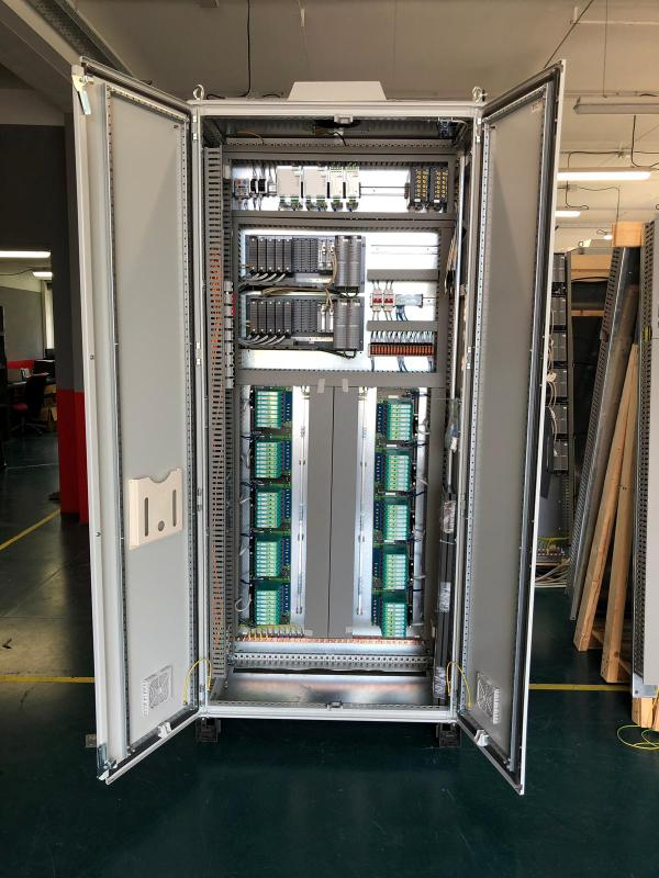 Remote input output cabinet